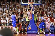 DESCRIZIONE : Campionato 2014/15 Serie A Beko Grissin Bon Reggio Emilia -  Dinamo Banco di Sardegna Sassar Finale Playoff Gara1<br /> GIOCATORE : Riccardo Cervi<br /> CATEGORIA : Schiacciata Controcampo<br /> SQUADRA : Grissin Bon Reggio Emilia<br /> EVENTO : LegaBasket Serie A Beko 2014/2015<br /> GARA : Grissin Bon Reggio Emilia - Dinamo Banco di Sardegna Sassari Finale Playoff Gara1<br /> DATA : 14/06/2015<br /> SPORT : Pallacanestro <br /> AUTORE : Agenzia Ciamillo-Castoria/GiulioCiamillo