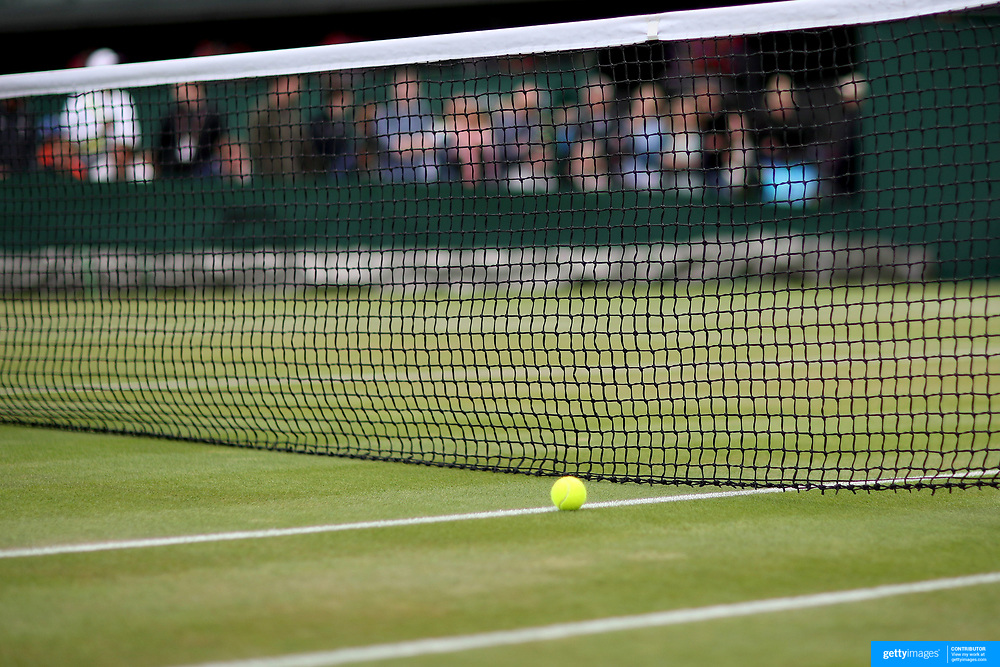 LONDON, ENGLAND - JULY 13:  A tennis ball on the  grass near the net on an outer court during the Wimbledon Lawn Tennis Championships at the All England Lawn Tennis and Croquet Club at Wimbledon on July 13, 2017 in London, England. (Photo by Tim Clayton/Corbis via Getty Images)