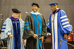 Former Gov. Charles W. Turnbull receives an honorary degree.  Fifty-first annual University of the Virgin Islands  Commencement Exercises.  UVI Sports & Fitness Center.  St. Thomas, VI.  14 May 2015.  © Aisha-Zakiya Boyd