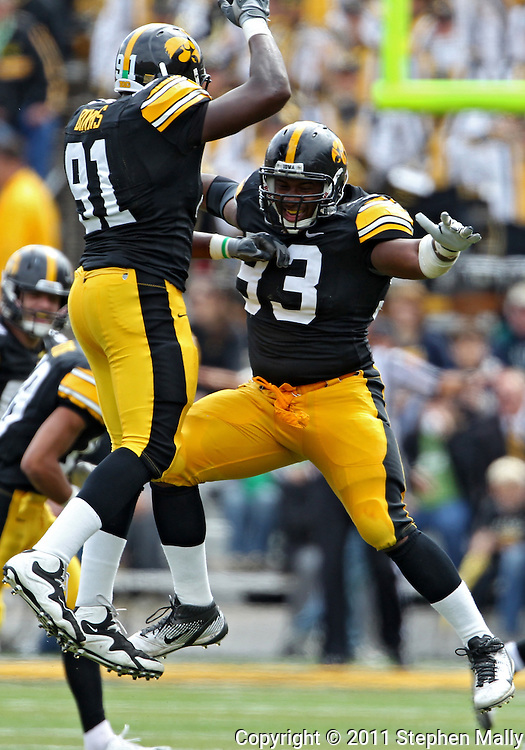 September 24, 2011: Iowa Hawkeyes defensive lineman Broderick Binns (91) and Iowa Hawkeyes defensive lineman Mike Daniels (93) celebrate after a missed field goal by the Louisiana Monroe Warhawks during the fourth quarter of the game between the Iowa Hawkeyes and the Louisiana Monroe Warhawks at Kinnick Stadium in Iowa City, Iowa on Saturday, September 24, 2011. Iowa defeated Louisiana Monroe 45-17.