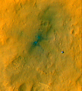 Tracks from the first drives of NASA's Curiosity rover are visible in this image captured by the HiRISE camera on NASA's Mars Reconnaissance Orbiter.