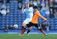 Chris Taylor, Blackburn Rovers midfielder and Joao Carlos Teixeira, Brighton midfielder during the Sky Bet Championship match between Blackburn Rovers and Brighton and Hove Albion at Ewood Park, Blackburn, England on 21 March 2015.