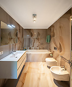 Elegant bathroom in precious marble. Nobody inside