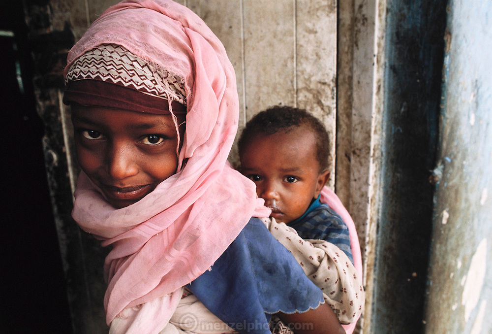 A young girl with her baby sister on her back in Hargeisa, Somaliland. Somaliland is the breakaway republic in northern Somalia that declared independence in 1991 after 50,000 died in civil war. March 1992.