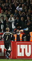 Photo: Paul Thomas.<br /> Bayer Leverkusen v Tottenham Hotspur. UEFA Cup. 23/11/2006.<br /> <br /> Paul Robinson, Spurs hero goal keeper throws his gloves into the away crowd after the match.