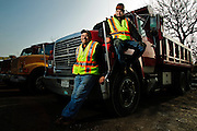 Humir Construction Project Manager Juan Arreloa (left) poses with Operations Manager and nephew Hugo Ramirez at the company's equipment yard on Chicago's near southwest side.