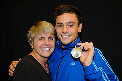 Tom Daley of Plymouth Diving poses with his Gold winners medal from the Mens 10m Platform Final and his new coach Jane Figueiredo, head of the new high performance diving centre in London - Photo mandatory by-line: Rogan Thomson/JMP - 07966 386802 - 02/02/2014 - SPORT - DIVING - Southend Swimming & Diving Centre, Southend-on-Sea - British Gas Diving National Cup 2014 Day 3.