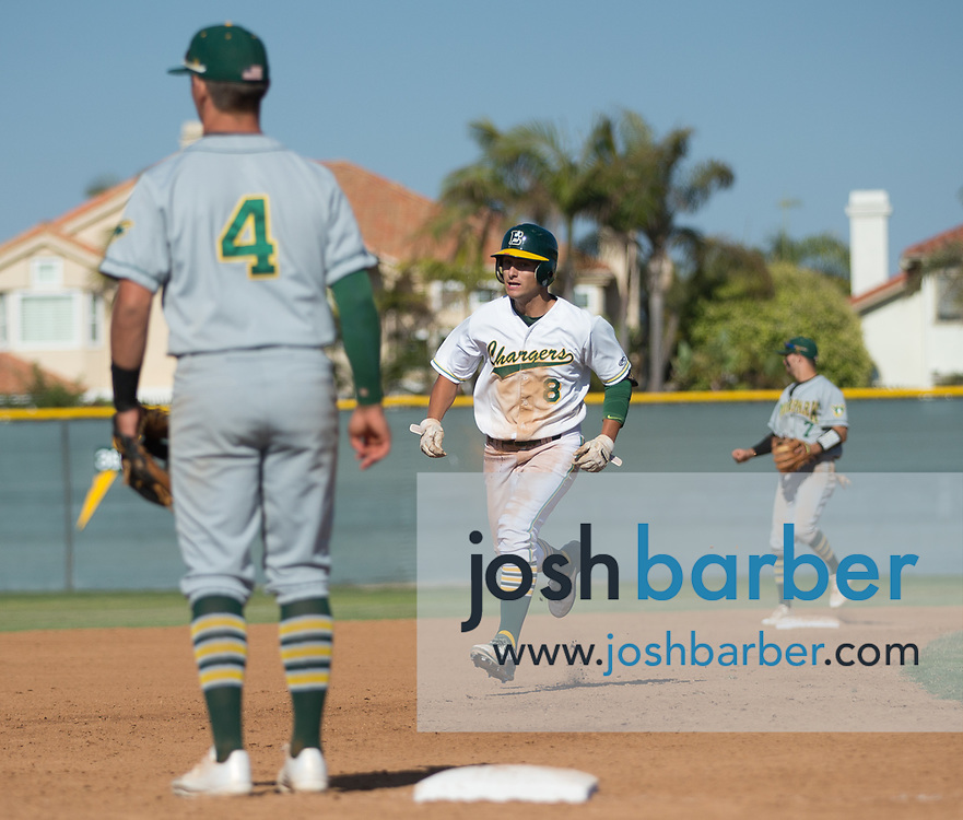 Edison's Vince Inman (8) heads to third base representing the winning run in the seventh inning during a CIF-SS Division 2 second round game against Moorpark at Edison High School on Tuesday, May 23, 2017 in Huntington Beach, California. (Photo/Josh Barber)