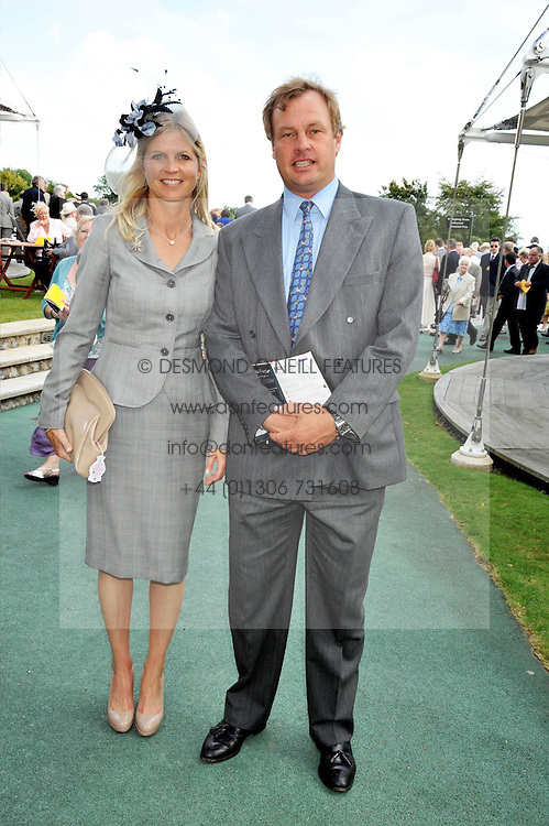 The MARQUESS & MARCHIONESS OF MILFORD HAVEN at day 1 of the annual Glorious Goodwood racing festival held at Goodwood Racecourse, West Sussex on 28th July 2009.