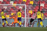 Football - 2020 / 2021 Sky Bet (EFL) Championship - Brentford vs. Huddersfield Town <br /> <br /> Ivan Toney (Brentford  FC) forces the save from Ben Hamer (Huddersfield Town) at the Brentford Community Stadium<br /> <br /> COLORSPORT/DANIEL BEARHAM