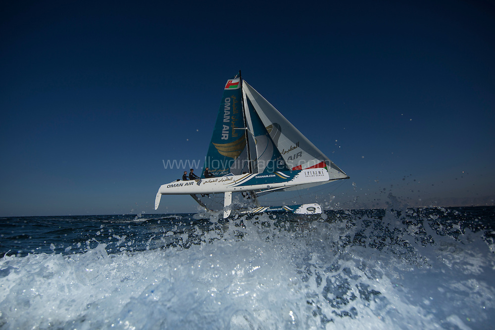 The Extreme Sailing Series 2014. Act 2. Muscat. <br /> Oman Air skippered Rob Greenhalgh (GBR) with headsail trimer Will Howden (GBR), trimer Tom Johnson (AUS), bowman Hashim Al Rashdi (OMA) and bowman Musab Al Hadi (OMA)<br /> Credit - Lloyd Images