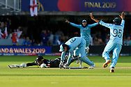 England Are World Champions - Jos Buttler of England breaks the stumps to complete the run out of Martin Guptill of New Zealand in the super over and England win the World Cup with Chris Woakes of England and Adil Rashid of England running in to celebrate during the ICC Cricket World Cup 2019 Final match between New Zealand and England at Lord's Cricket Ground, St John's Wood, United Kingdom on 14 July 2019.