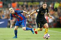 FC Barcelona's Leo Messi (l) and Atletico de Madrid's Filipe Luis during La Liga match. September 21,2016. (ALTERPHOTOS/Acero)