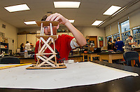 Dylan Greer builds a windmill in Mr. White's 8th grade class as part of their engineering project on Wednesday morning.  (Karen Bobotas/for the Laconia Daily Sun)