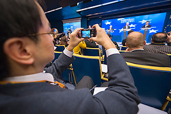 A journalist snaps a picture of Herman Van Rompuy, president of the European Council, and Jose Manuel, Barroso, president of the European Commission, during the EU Council President's press conference, following the conclusion of the EU Summit, at the European Council headquarters in Brussels, Belgium on Friday, Dec. 14, 2012. (Photo © Jock Fistick)