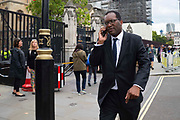 Kwasi Kwarteng, Secretary of State for Business, Energy and Industrial Strategy speaks on his mobile phone outisde the Houses of Parliament in London, United Kingdom on 10th September 2019.