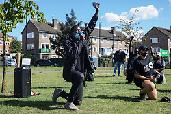 Slough, UK. 13 June, 2020. Local people take a knee during a peaceful protest in solidarity with the Black Lives Matter movement in Salt Hill Park. Protests in solidarity with the Black Lives Matter movement have taken place across the United States and in many countries around the world.