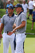JERSEY CITY, NJ - SEPTEMBER 27:  Jordan Spieth of the USA and  Patrick Reed of the USA  during Day 3 practice of the Presidents Cup on September 27, 2017, at Liberty National Golf Club in Jersey City, NJ.  (Photo by Rich Graessle/Icon Sportswire)