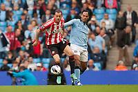 Football - Premier League - Manchester City vs. Sunderland<br /> Steven Fletcher of Sunderland and Joleon Lescott of Manchester City at the Etihad Stadium