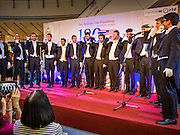 "19 JULY 2013 - BANGKOK, THAILAND:   The Yale Whiffenpoofs, one of the best-known collegiate a cappella groups in the world performed in CentralWorld in Bangkok Friday. Founded in 1909, the ""Whiffs"" began as a senior quartet that met for weekly concerts at Mory's Temple Bar, the famous Yale tavern. The Bangkok stop was a part of their 2013 world tour and was sponsored by the US Embassy. They sang at the opening of a photo exhibit that marked 180 years of friendly diplomatic relations between Thailand and the United States.   PHOTO BY JACK KURTZ"