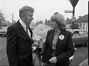 15/05/1982<br /> 05/15/1982<br /> 15 May 1982<br /> An Taoiseach, Mr Charles Haughey, canvasing with Fianna Fail bye-election candidate Eileen Lemass in Dublin West. Minister for Justice, Sean Doherty T.D. rests his hand on a Garda motorcycle while chatting to Eileen Lemass.