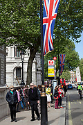 Preparations for the Royal Wedding. Whitehall in central London is now decked out with rows of giant Union Jack flags along the parade route.
