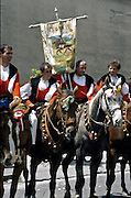 """Cavalcata Sarda, Sassari. Ryttere fra landsbyen Fonni. In Sardinia there are more than 200 festivals and events during the year, but only 3 offer the opportunità to see united, un the same place, all the traditional customs of the isle: Sant'Efisio at Cagliari, the Redentore at Nuoro and the Cavalcata Sarda at Sassari.<br /> The Cavalcata, that is different from the other two celebration because it's not a religious celebration, it join varoius aspects of celebration: there is the presentation of the customs then there is one component more sportive with skills by the riders (""""pariglie""""), elements typically of folk-lore: songs and dances tha last until late hour."""