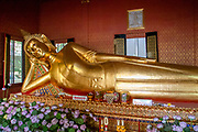 The Reclining Buddha of Wat Pho Temple in Bangkok. The temple was founded in the 16th century