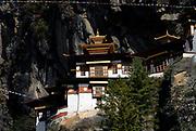 Paro Taktsang Goemba, monastery, know as the  Tigers Nest is perched precariously half way up a mountain side cliff.  Paro Taktsang Bhutan, Druk Yul. 11 November 2007