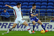 Cardiff City's Tom Lawrence (l) takes on M K Don's Joe Walsh. Skybet football league championship match, Cardiff city v MK Dons at the Cardiff city stadium in Cardiff, South Wales on Saturday 6th February 2016.<br /> pic by Carl Robertson, Andrew Orchard sports photography.
