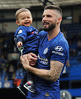 Football - 2018 / 2019 Premier League - Chelsea vs. Watford<br /> <br /> Olivier Giroud of Chelsea walks around the pitch with his child after the final home match, at Stamford Bridge.<br /> <br /> COLORSPORT/ANDREW COWIE