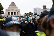 A police officer is seen ordering the crowd to disperse during the Melbourne Freedom Rally at The Shrine. Premier Daniel Andrews promises 'significant' easing of Stage 4 restrictions this weekend. This comes as only one new case of Coronavirus was unearthed over the past 24 hour and no deaths. (Photo by Dave Hewison/Speed Media)