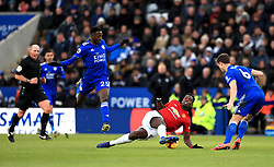 Manchester United's Paul Pogba (second right) battles for the ball with Leicester City's Jonny Evans (right) and Wilfred Ndidi during the Premier League match at the King Power Stadium, Leicester.
