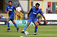 AFC Wimbledon defender Toby Sibbick (20) dribbling during the Pre-Season Friendly match between AFC Wimbledon and Queens Park Rangers at the Cherry Red Records Stadium, Kingston, England on 14 July 2018. Picture by Matthew Redman.