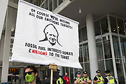 An environmental activist from Extinction Rebellion holds a banner outside the News Building, the London base of News UK, during an Impossible Tea Party event on 30th August 2021 in London, United Kingdom. Extinction Rebellion called on the media to report much more extensively on the climate emergency and drew attention to financial institutions funding fossil fuel projects on the eighth day of their Impossible Rebellion protests in London.