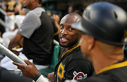 Jun 15, 2018; Pittsburgh, PA, USA; Pittsburgh Pirates center fielder Starling Marte (6) talks with Pittsburgh Pirates third base coach Joey Cora (28) in the dugout during the fifth inning against the Cincinnati Reds at PNC Park. Mandatory Credit: Ben Queen-USA TODAY Sports