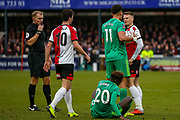 Watford defender Adam Masina (11) and Woking's Armani Little square up during the The FA Cup 3rd round match between Woking and Watford at the Kingfield Stadium, Woking, United Kingdom on 6 January 2019.