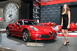 """12 February 2015: Displayed by a female model - 2015 Alfa Romeo 4C: Alfa Romeo likes to call their all-new 2015 4C Coupe, """"The Attainable Supercar."""" With groundbreaking Italian design and clever technological solutions, the company can offer the 4C Coupe for a fraction of the price of other exotic supercars. With design nods to history, the 4C and 4C Launch Edition makes reference to the style of the 1967 33 Stradale, and combines Alfa Romeo engineering and Maserati manufacturing into one. Outer body is made of Sheet Molded Compound (SMC) that is 20-percent lighter than steel. The monocoque of the Alfa Romeo 4C – weighing only 236 lbs – is a single carbon fiber body, just like a supercar, in which space is cut out for the driver and a passenger.  With its transverse-mounted mid-engine configuration, the new, direct injection, 237-horsepower 1.75-liter turbocharged four-cylinder engine, entirely made of aluminum, brings extraordinary performance with a peak torque of 258 lb-ft. to the rear wheels. Sole transmission is a six-speed dual-clutch sequential manual. The combination puts the accent on smooth running for the under 2,500-lb. sports car. And, while emitting baritone exhaust sounds, the 4C can dashes from 0-60 mph in 4.1 seconds, and reach a top speed of 160 mph.  A rear storage compartment behind the seating accommodates small parcels. The 2015 Alfa Romeo 4C will have a limited production run, including the 500 Launch Editions scheduled for U.S. buyers only.<br /> <br /> First staged in 1901, the Chicago Auto Show is the largest auto show in North America and has been held more times than any other auto exposition on the continent. The 2015 show marks the 107th edition of the Chicago Auto Show. It has been  presented by the Chicago Automobile Trade Association (CATA) since 1935.  It is held at McCormick Place, Chicago Illinois"""