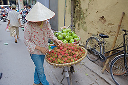Woman Selling Fruit From Bicycle