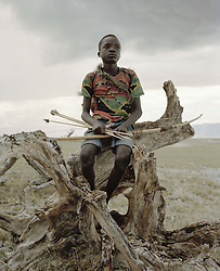 October 3, 2018 - Lake Eyasi, Ngorongoro district, Tanzania - Manu (14)The Hadza are one of the last remaining societies, which remain in the world, that survive purely from hunting and gathering. Very little has changed in the way the Hadza live their lives. But it has become increasingly harder for them to pursue the Hadza way of life. Either the Hadza will find a way to secure their land-rights to have access to unpolluted water springs and wild animals, or the Hadzabe lifestyle will disappear, with the majority of them ending up as poor and uneducated individuals within a Westernized society that is completely foreign to them. The hunter gatherer Hadza way of live is under threat. (Credit Image: © Stefan Kleinowitz/ZUMA Wire)