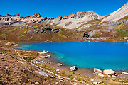 Upper Ice Lake glows with stunningly bright turquoise and green-blue colors, unique in my experience. I hiked Ice Lakes Basin as a memorable loop (8.9 miles with 3120 feet gain) from USFS South Mineral Campground to Lower and Upper Ice Lakes, then up to Fuller Lake, and back via Island Lake, near Silverton, Colorado, USA. Or, to Upper Ice Lake alone is 7.4 miles round trip with 2400 ft gain. Silverton, San Juan Mountains, San Juan National Forest, Colorado, USA.