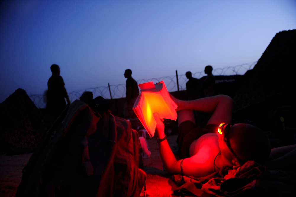 9/7/10 1:08:56 AM -- -- <br /> 1st Battalion, 2nd Marine Regiment, Weapons Company, LCPL John Fankboner, 23, reading a book via a headlamp before falling asleep in the heat and under stars at the remote outpost Kunjak near Musa Qala, Helmand Province, Afghanistan. Fankboner has been in an armored vehicle near or hit by at least three IED's (Improvised Explosive Devices) while deployed in Helmand, Afghanistan.<br /> <br /> Photo by Jack Gruber, USA TODAY Staff