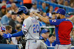 April 29, 2018 - Toronto, ON, U.S. - TORONTO, ON - APRIL 29:  Texas Rangers Infield Renato Nunez (20) has his batting hat hit askew by teammate (on the DL) Second base Rougned Odor (12) after Nunez's solo home run in the 1st inning during the MLB game between the New York Yankees and the Toronto Blue Jays on April 29, 2018 at Rogers Centre in Toronto, ON. (Photo by Jeff Chevrier/Icon Sportswire) (Credit Image: © Jeff Chevrier/Icon SMI via ZUMA Press)