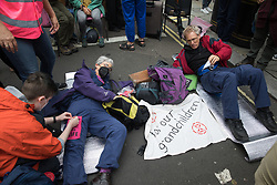 London, UK. 23rd August, 2021. Environmental activists from Extinction Rebellion use a lock-on to block a road in the Covent Garden area during the first day of Impossible Rebellion protests. Extinction Rebellion are calling on the UK government to cease all new fossil fuel investment with immediate effect. Credit: Mark Kerrison/Alamy Live News