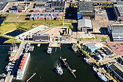 Nederland, Noord-Holland, Amsterdam, 27-09-2015;<br /> Amsterdam-Noord, Veer NDSM-werf. NDSM-plein en Mt. Ondinaweg. Aanleg van de pont naar Houthaven en CS. Stadsontwikkelinggebied.<br /> Amsterdam-North, former shipyard area. Urban development.<br /> luchtfoto (toeslag op standard tarieven);<br /> aerial photo (additional fee required);<br /> copyright foto/photo Siebe Swart