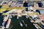 Nederland, Noord-Holland, Amsterdam, 27-09-2015;<br /> Amsterdam-Noord, Veer NDSM-werf. NDSM-plein en Mt. Ondinaweg. Aanleg van de pont naar Houthaven en CS. Stadsontwikkelinggebied.<br /> Amsterdam-North, former shipyard area. Urban development.<br /> luchtfoto (toeslag op standard tarieven);<br /> aerial photo (additional fee required);<br /> copyright foto/photo Siebe Swart