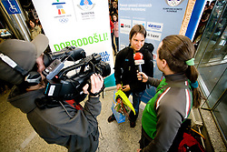 Slovenian biathlon athlete Teja Gregorin and journalist of Siol Sportal Rok Plestenjak at arrival to Airport Joze Pucnik from Vancouver after Winter Olympic games 2010, on February 26, 2010 in Brnik, Slovenia. (Photo by Vid Ponikvar / Sportida)