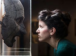 Hundreds of objects from Edinburgh's museum and gallery collections have been drawn together and placed on display for the very first time.<br /> <br /> Spanning 60,000 years and over 300 items, Edinburgh Alphabet: An A-Z of the City's Collections combines artworks and artefacts across four floors of the City Art Centre this summer (Friday 19 May – 8 October).<br /> <br /> Rare and unusual museum items on display for the first time include architect Thomas Hamilton's winning design for the Burns Monument in 1831 and intricate set designs for King's Theatre pantomimes, which have been conserved ahead of their unveiling in Edinburgh Alphabet.<br /> <br /> They are being displayed alongside stone-age discoveries from archaeological excavations, unique examples of historic glass and ceramics from the Council's applied art collections, toys from the Museum of Childhood and favourites from the City Art Centre collection, including John Duncan's Tristan and Isolde, Cadell's Black Hat and a newly acquired painting Moon by Alison Watt.<br /> <br /> The display coincides with the Scottish Government's Year of History, Heritage and Archaeology and this summer's Edinburgh Art Festival.<br /> <br /> Pictured: Curator of Fine Art, Helen Scott and the David Mach sculpture Local Hero