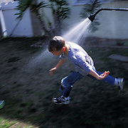 A box of grass seed tossed aside, a science lesson in the backyard ended with Jeanne initiating an impromptu water fight on a hot January Friday.