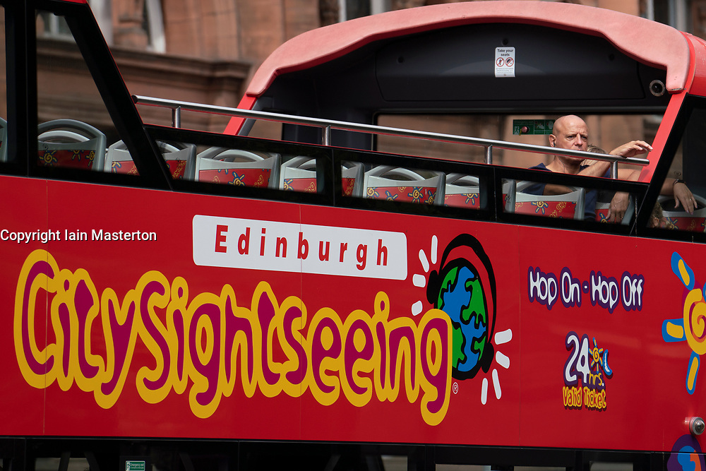 Edinburgh, Scotland, UK. 12 July, 2020, Business slowly returning to normal in Edinburgh city centre. Tourists still almost non existent and streets remain very quiet in the Old Town. Tourist city sightseeing buses are now operating from the Royal Mile but very few people on board. Iain Masterton/Alamy Live News